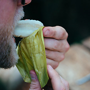 Andrew Whiteford eats lunch in the jungle near Chiang Dao, Thailand.