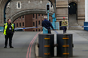 """Police and London Fire Brigades are responding to an incident in Tower Bridge of London, on Friday, June 19, 2020. """"Somebody is alleged to be willing to jump off the Bridge,"""" said a member of LFB without giving any further details. (Photo/ Vudi Xhymshiti)"""