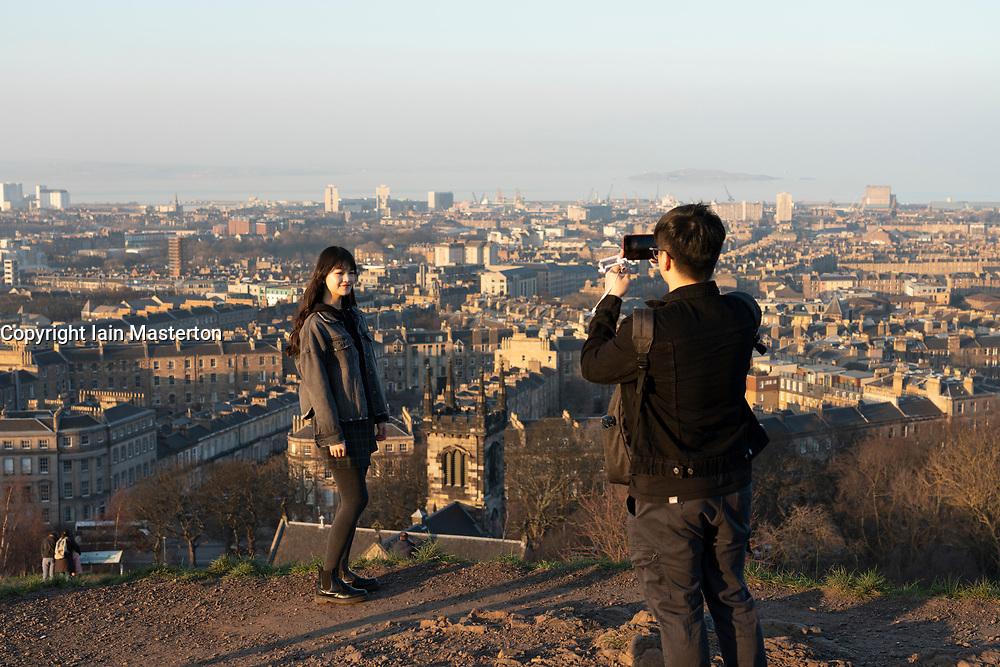Edinburgh, Scotland, UK. 26 February, 2019. Tourists enjoy view of Leith from Calton Hill in Edinburgh after a warm clear day , Edinburgh, Scotland, UK