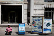 Falun Gong permanent protest opposite the Chinese Embassy on Portland Place, London.Peacefully protest in meditation 24/7 since 2002. A very spiritual demonstration against an oppressive regime. Flun gong claim the following: On July 20, 1999, the Chinese Communist Party (CCP) launched the persecution against Falun Gong. Over the last nine years, 3,168 Falun Gong practitioners have lost their lives, many tortured to death; 75 of them were people in their eighties, and the youngest was only 8 months old. Thousands of practitioners are currently jailed and being tortured in forced labour camps, detention centres and prisons. The CCP even harvests organs from living Falun Gong practitioners for profit.