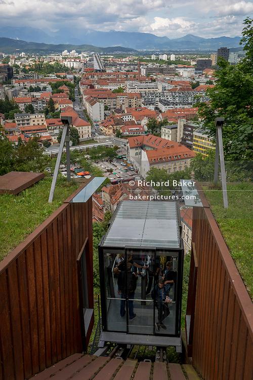 Funicular passengers arrive at the top of Ljubljana Castle in the Slovenian capital, on 27th June 2018, in Ljubljana, Slovenia.