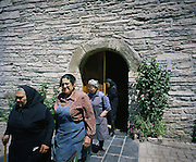 Women going out from the mass. Since the priest doesn't go everyday to the village all the women go to the church and pray to all toghether.