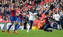 05 November 2017 Wembley : Premier League Football : Tottenham Hotspur v Crystal Palace : Andros Townsend of Palace pulls the shorts of Moussa Sissoko  and the Tottenham player falls and loses a boot.