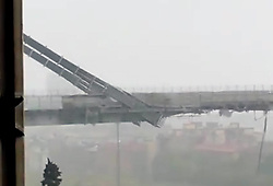 A major motorway bridge has collapsed near the Italian City of Genoa. The bridge known as Ponte Morandi is part of the A10 Motorway connecting the city of Genoa to Savona and Ventimiglia collapsed this morning (frame, Genoa - 2018-08-14) This photo is usable in respect of the context in which has been taken, and without the defamatory intent of the decoration of the persons represented