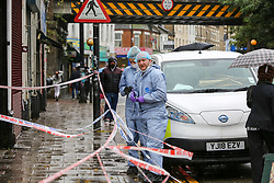 © Licensed to London News Pictures. 13/10/2019. London, UK. Forensic officers outside West Green Halal Meat and Groceries store on West Green Road in Tottenham, North London where two men were stabbed and rushed to hospital shortly after 9.30am this morning. The ages of the two victim and their condition is not yet know. Photo credit: Dinendra Haria/LNP