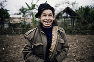 Portrait of a toothless man smiling to the camera. Ha Giang province, Vietnam, Asia