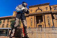 Public art: Nelson Mandela boxing, Magistrate Court in background, Johannesburg, South Africa.