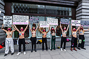 Undressed XR Fashion Rebellion activists hold banners and placards outside H & M as they staged a demonstrative stunt targeting main fashion firms in Oxford Circus high street on Wednesday, Sept 9, 2020. Environmental nonviolent activists group Extinction Rebellion enters its 9th day of continuous ten days protests to disrupt political institutions throughout peaceful actions swarming central London into a standoff, demanding that central government obeys and delivers Climate Emergency bill. (VXP Photo/ Vudi Xhymshiti)