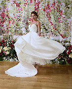 Fashion demonstrates with a dress twirl the appeal of her wedding dress.
