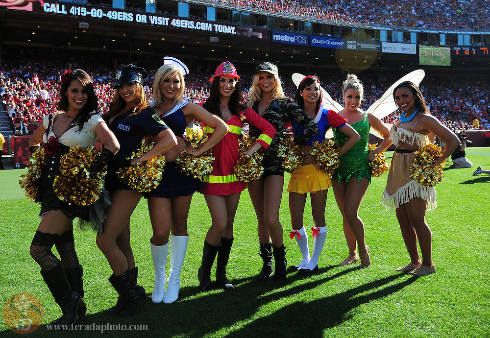 October 30, 2011; San Francisco, CA, USA; San Francisco 49ers Gold Rush cheerleaders (L-R) Priscilla, Antonia, Heidi, Rachel M., Elizabeth, Aleena, Amy, and Tyesha pose for a photo in their halloween costumes during the third quarter against the Cleveland Browns at Candlestick Park. The 49ers defeated the Browns 20-10.
