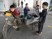 children playing with a bicycle cart China Beijing