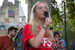 London, UK. 2 September, 2019. A speaker from For Our Future's Sake addresses hundreds of people attending a 'Stop the Coup' protest in Parliament Square following Prime Minister Boris Johnson's address to the nation outside 10 Downing Street to the effect that there will be a vote on a general election if MPs vote for a further delay to Brexit.