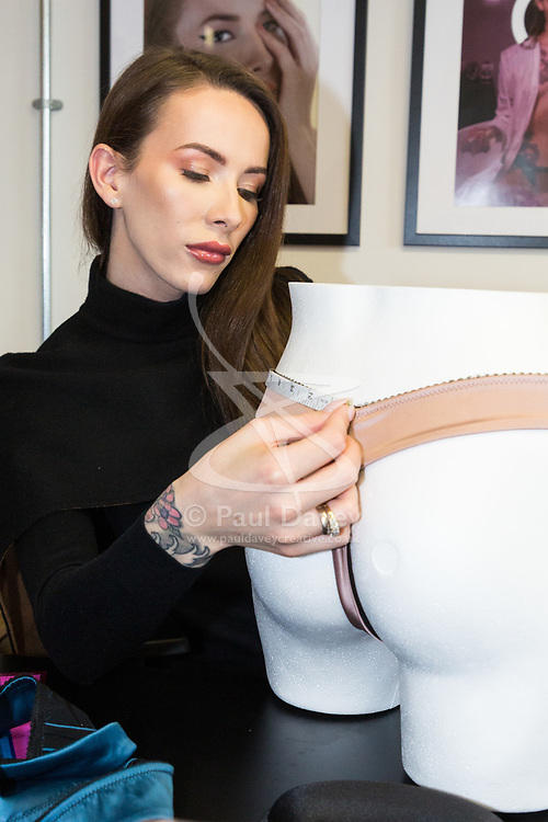 Transgender woman Carmen Liu, who has created the first line in lingerie specifically aimed at the transgender market in her Fulham, West London office as manufacturing gets underway in Lithuania ahead of her launch. London, February 13 2019.
