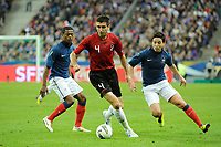 FOOTBALL - UEFA EURO 2012 - QUALIFYING - GROUP STAGE - GROUP D - FRANCE v ALBANIA - 07/10/2011 - PHOTO JEAN MARIE HERVIO / DPPI - ARMEND DALLKU (ALB) / PATRICE EVRA / SAMIR NASRI (FRA)