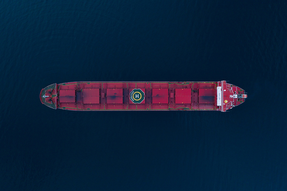 Top down aerial view of the bulk carrier 'Nordic Odin' anchored in the Ofot fjord in Narvik, Northern Norway.