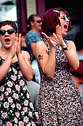 Friends age 19 applauding music act at Grand Old Day festival.  St Paul  Minnesota USA