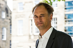 Pictured: Charles Cumming<br /> <br /> Charles Cumming (born 5 April 1971) is a British writer of spy fiction. Cumming was born in Ayr in Scotland, the son of Ian Cumming (b. 1938) and Caroline Pilkington (b. 1943).<br /> <br /> He was educated at Ludgrove School (1979–1984), Eton College (1985–1989) and the University of Edinburgh (1990–1994), where he graduated with 1st Class Honours in English Literature. In 1995, Cumming was approached for recruitment by the United Kingdom's Secret Intelligence Service (MI6) but did not go on to work for them.