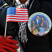 A woman awaits the arrival of President-elect Obama during a pre-inauguration rally in Wilmington, Delaware.  She was one in a crowd of thousands that braved sub-zero temperatures to lend her support.   Obama, Vice President-elect Biden and their families traveled by train on a Whistle Stop Tour, opening Inauguration celebrations with rallies in Philadelphia, Wilmington, and Baltimore before their final arrival in Washington, D.C.  The inauguration takes place on January 20, 2009, swearing Obama in as the 44th President of the United States of America.¬?