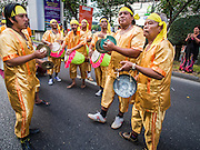 """14 JANUARY 2015 - BANGKOK, THAILAND: Traditional drummers perform in the 2015 Discover Thainess parade. The Tourism Authority of Thailand (TAT) sponsored the opening ceremony of the """"2015 Discover Thainess"""" Campaign with a 3.5-kilometre parade through central Bangkok. The parade featured cultural shows from several parts of Thailand. Part of the """"2015 Discover Thainess"""" campaign is a showcase of Thailand's culture and natural heritage and is divided into five categories that match the major regions of Thailand – Central Region, North, Northeast, East and South.     PHOTO BY JACK KURTZ"""