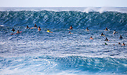 Surfers Ready to Catch a Big Wave