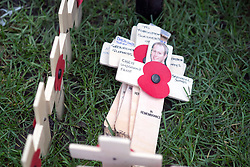 © Licensed to London News Pictures. 05/11/2014. London, UK. Crosses wait to be planted. Every November the annual Field of Remembrance at Westminster Abbey is organised and run by The Poppy Factory. Over 350 plots for regimental and other associations are laid out in the area between Westminster Abbey and St. Margaret's Church. Remembrance crosses are provided so that ex-Service men and women, as well as members of the public, can plant a cross in memory of their fallen comrades and loved ones.<br /> . Photo credit : Stephen Simpson/LNP