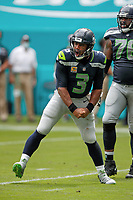Seattle Seahawks quarterback Russell Wilson (3) reacts to a touchdown during an NFL football game against the Miami Dolphins, Sunday, Oct. 4, 2020 in Miami Gardens, Fla.<br /> <br /> ( Tom DiPace via AP)