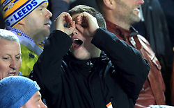 A Leeds United fan in the stands makes a binoculars gesture during the Sky Bet Championship match at Elland Road, Leeds.