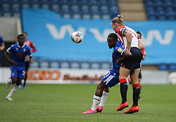 Callum Harriott of Colchester United and Carl Piergianni of Oldham Athletic tussle for the ball - Mandatory by-line: Arron Gent/JMP - 03/10/2020 - FOOTBALL - JobServe Community Stadium - Colchester, England - Colchester United v Oldham Athletic - Sky Bet League Two