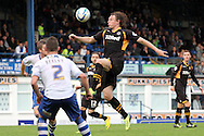 Newport County's Adam Chapman acrobatically strikes the ball at goal but just misses. Skybet Football League two match, Bury v Newport county at Gigg Lane in Bury on Saturday 5th Oct 2013. pic by David Richards, Andrew Orchard sports photography,