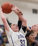 Cedar Ridge senior Courtney Brown gets fouled going towards the basket Tuesday against Round Rock.  The Raiders easily beat the Dragons.  (LOURDES M SHOAF for the Round Rock Leader.)