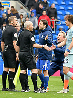 Football - 2018 / 2019 Premier League - Cardiff City vs. Chelsea<br /> <br /> Cardiff City manager Neil Warnock pulls Harry Arter of Cardiff City away from referee Mr C. Pawson after the game , at Cardiff City Stadium.<br /> <br /> COLORSPORT/WINSTON BYNORTH