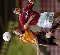 Fotball<br /> Treningskamp England<br /> <br /> Foto: Richard Lane, Digitalsport<br /> NORWAY ONLY<br /> <br /> Northampton Town v Wolverhampton Wanderers<br /> Pre season friendly. 24/07/2004.<br /> <br /> Jody Craddock gets to the ball ahead of Scott McGlesh