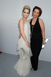 Left to right, RITA ORA and her mother at the Glamour Women of the Year Awards in association with Pandora held in Berkeley Square Gardens, London on 4th June 2013.