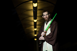 © Licensed to London News Pictures . 16/12/2015 . Manchester , UK . Anakin Skywalker on a pedestrian walkway outside the cinema . Star Wars fans attend the midnight screening of Star Wars the Force Awakens at the AMC Great Northern cinema in Manchester City Centre . Photo credit : Joel Goodman/LNP