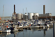 Oil storage tanks and power station chimneys, St Sampson harbour, Guernsey