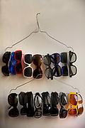 Sunglasses hanging on 2 coathangers