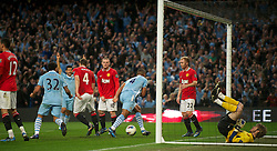 MANCHESTER, ENGLAND - Monday, April 30, 2012: Manchester City's Vincent Kompany celebrates scoring the first goal against Manchester United during the Premiership match at the City of Manchester Stadium. (Pic by Chris Brunskill/Propaganda)