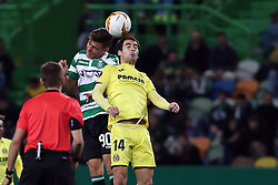 February 14, 2019 - Lisbon, Portugal - Sporting's midfielder Miguel Luis from Portugal heads the ball with Villarreal's midfielder Manu Trigueros (R ) during the UEFA Europa League Round of 32 First Leg football match Sporting CP vs Villarreal CF at Alvalade stadium in Lisbon, Portugal on February 14, 2019. (Credit Image: © Pedro Fiuza/ZUMA Wire)