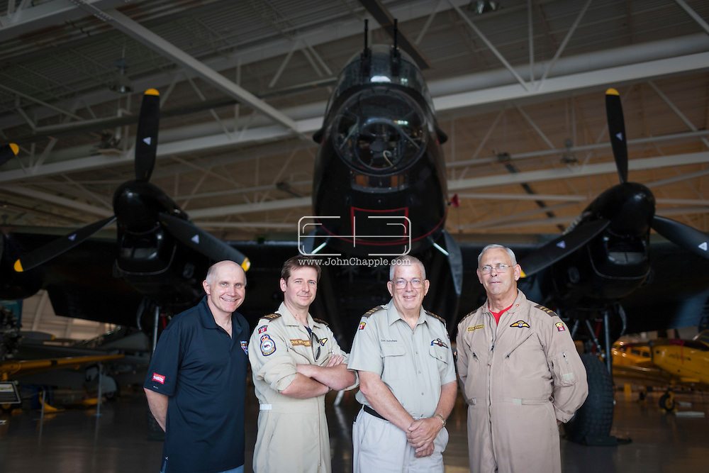 July 30, 2014. Hamilton, Ontario, Canada. The Canadian Warplane Heritage Museum will be flying their prized Avro Lancaster to England to join the only other airworthy Lancaster in the world, owned and operated by the Royal Air Force's renowned Battle of Britain Memorial Flight. Pictured is the flight crew (L-R) Randy Straughan, Craig Brookhouse, Don Schofield, Leon Evans.<br /> Photo Copyright John Chapple / www.JohnChapple.com