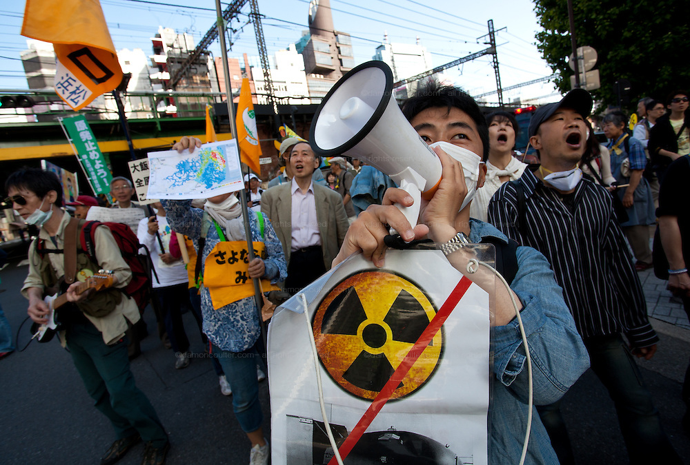 Protesters at an anti nuclear protest outside the TEPCO headquarters in. Tokyo, Japan Sunday June 2nd 2013