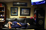 Mariners head groundskeeper Bob Christofferson naps for a few minutes during a break in his 16-hour day prepping Safeco field for a game against the Toronto Blue Jays, Sept. 20, 2016 at Safeco Field. During the season, he often sleeps in his office overnight when a night game is followed by an early day game.  (Genna Martin, seattlepi.com)