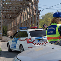 Police cars and officers guard the entrance of public parks ordered to be closed off from visiting for Easter weekend because of the COVID19 corona virus pandemic in Budapest, Hungary on April 10, 2020. ATTILA VOLGYI