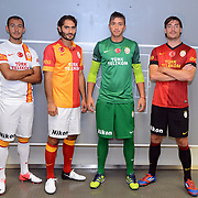 Turkish soccer team Galatasaray players (Left to Right) Umut Bulut, Hamit Altintop, goalkeeper Nestor Fernando Muslera, Albert Riera Ortega pose during the presentation of the new uniform at the TT Arena in Istanbul Turkey on Wednesday, 18 July 2012. Photo by TURKPIX