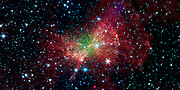 The 'Dumbbell nebula,' also known as Messier 27, pumps out infrared light in this image from NASA's Spitzer Space Telescope.