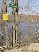 Warning and prohibition signs in the middle of a nature landscape.