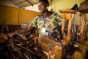 A vendor selling wooden carvings at the Village Artisanal de Ouagadougou, a cooperative that employs dozens of artisans who work in different mediums, in Ouagadougou, Burkina Faso, on Monday November 3, 2008.