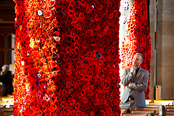 © Licensed to London News Pictures. 9/10/2018. Warwick, UK. Poppy display. Sixty two thousand, four hundred and thirty eight poppies have been assembled in St Mary's  church Warwick to commemorate the ending of the first World War. The poppies have been produced by local people, groups and school children with six hundred and ten alone covering the bell near the altar. As well as red poppies there are differing colours to signify conscious objectors, animals and pigeons killed in the Great War. Pictured one of the main plinths in the church. Photo credit: Dave Warren/LNP