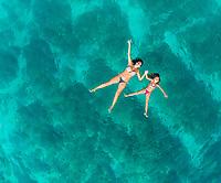 Aerial view of woman and young girl swimming in sea, Brac island, Croatia.