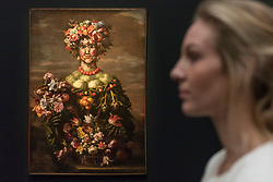 """© Licensed to London News Pictures. 01/12/2017. London, UK.  A staff member views one from """"The Four Seasons: Four Anthromophorphic Figures"""", series, Rome 1608, After 1673, attributed to Giovanni Stanchi, (Est. GBP250-350k).  Preview of """"Masters of Light"""", Sotheby's Old Masters Evening Sale which will take place on 6 December at Sotheby's, New Bond Street. Photo credit: Stephen Chung/LNP"""
