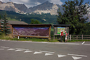 Hikers in front of panaoramic view of Dolomites mountains in La Villa, in Alta Badia, south Tyrol, Italy.